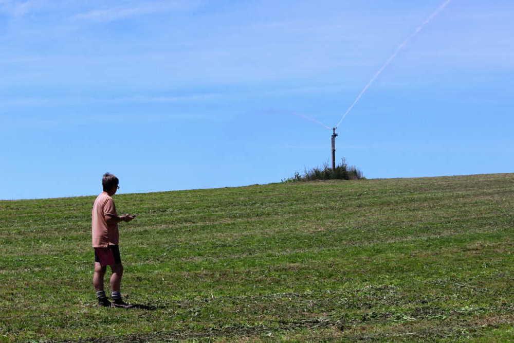 Farmer operating IPC fixed grid irrigation sprinkler